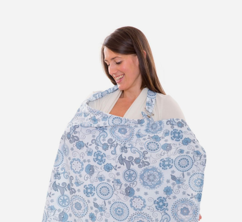woman smiling down at My Brest Friend nursing cover