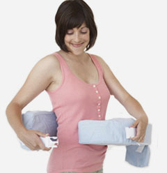 woman wrapping the My Brest Friend pillow around herself